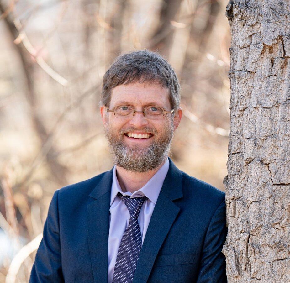 Dr. Travis Cox